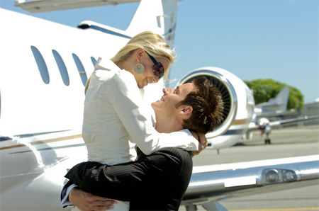 Romantic Couple in front of Private Jet on Valentines Day